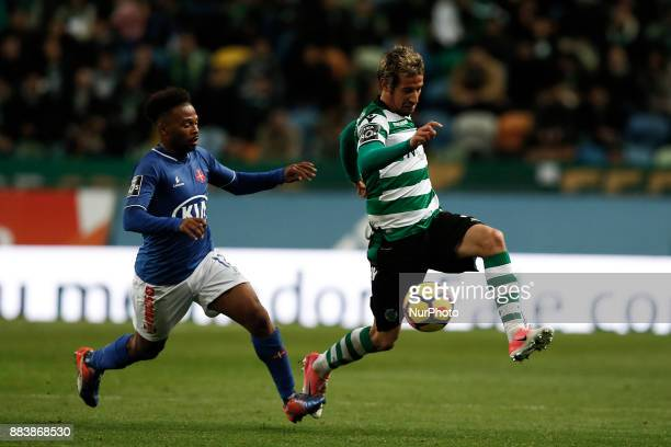 Belenenses's forward Fredy vies for the ball with Sporting's defender Fabio Coentrao during Primeira Liga 2017/18 match between Sporting CP vs CF...