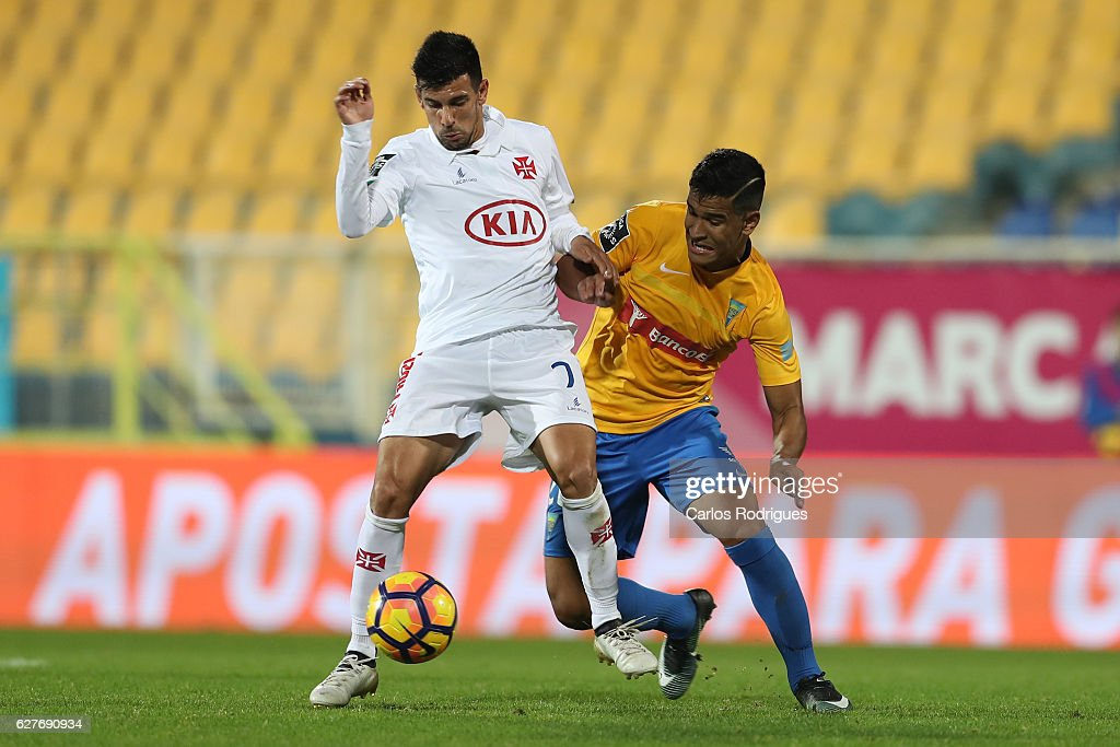 Belenenses's forward Miguel Rosa from Portugal (L) vies with Estoril's midfielder Matheus Indio from Brazil (R) during the match between Estoril Praia SAD and CF Os Belenenses for the Portuguese Primeira Liga at Estadio Antonio Coimbra da Mota on August 21, 2016 in Lisbon, Portugal.