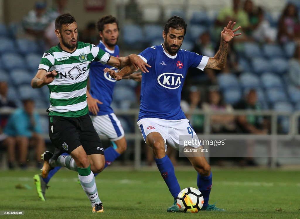 Belenenses's forward Tiago Caeiro from Portugal (R) with Sporting CP's midfielder Bruno Fernandes from Portugal (L) in action during the Pre-Season Friendly match between Sporting CP and CF' Belenenses at Estadio Algarve on July 7, 2017 in Faro, Portugal.