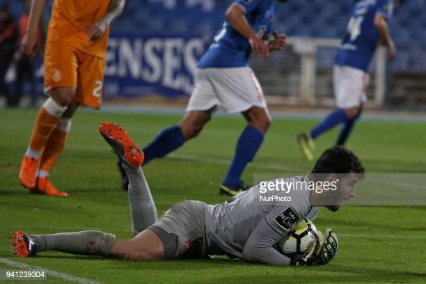 Belenenses's goalkeeper Andre Moreira makes a safe during the Portuguese League football match Belenenses vs FC Porto at the Restelo stadium in...
