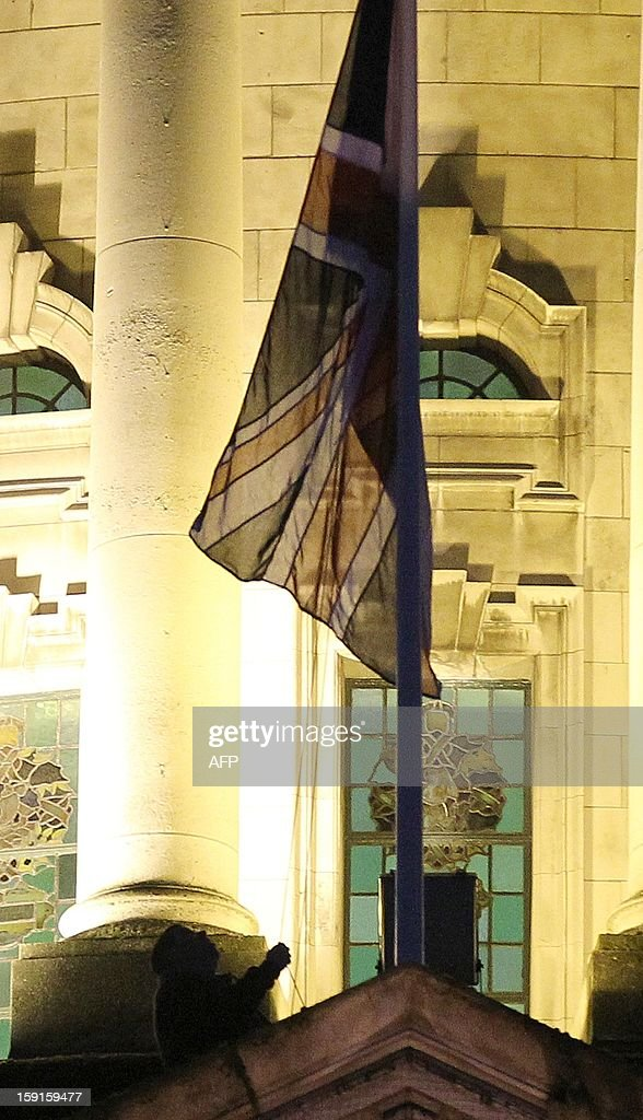 A Belfast City Council worker raises the union flag at Belfast City Hall in Belfast, Northern Ireland to mark the Duchess of Cambridge's 31st birthday on January 9, 2013 for the first time since a decision not to display it permanently sparked protests, some of which have been violent. The British flag was hoisted over Belfast's City Hall for the first time since its removal a month ago sparked riots in Northern Ireland. On a sixth consecutive night of violence in the British province, protesters pelted police in the capital Belfast with petrol bombs, fireworks, bottles and stones.
