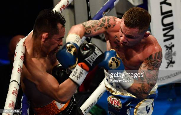 Belfast Ireland 21 April 2018 Carl Frampton right in action against Nonito Donaire during their Vacant WBO Interim World Featherweight Championship...