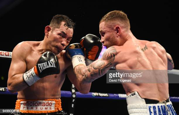 Belfast Ireland 21 April 2018 Nonito Donaire left in action against Carl Frampton during their Vacant WBO Interim World Featherweight Championship...