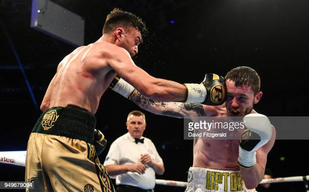 Belfast Ireland 21 April 2018 Tyrone McKenna left in action against Anthony Upton during their SuperLightweight bout at the Boxing in SSE Arena...