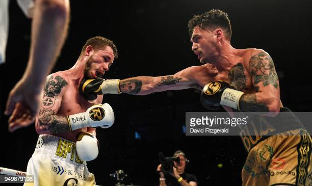 Belfast Ireland 21 April 2018 Tyrone McKenna right in action against Anthony Upton during their SuperLightweight bout at the Boxing in SSE Arena...
