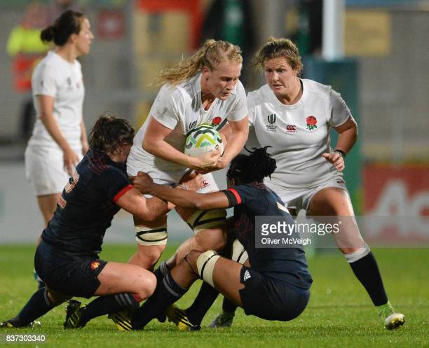 Belfast Ireland 22 August 2017 Alex Matthews of England is tackled by Gaelle Mignot and Julie Annery of France during the 2017 Women's Rugby World...