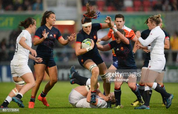 Belfast Ireland 22 August 2017 Lenaig Corson of France is tackled by Alex Matthews of England during the 2017 Women's Rugby World Cup SemiFinal match...