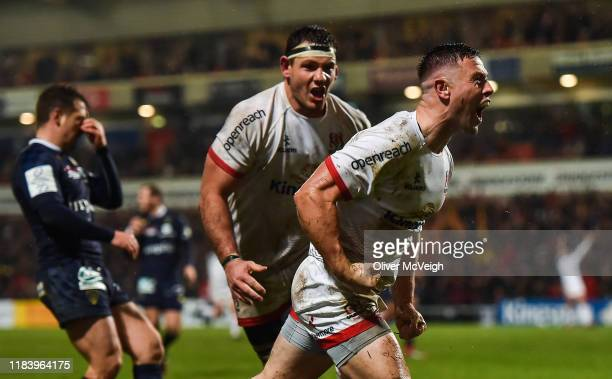 Belfast , Ireland - 22 November 2019; John Cooney of Ulster celebrates after scoring his side's second try during the Heineken Champions Cup Pool 3...