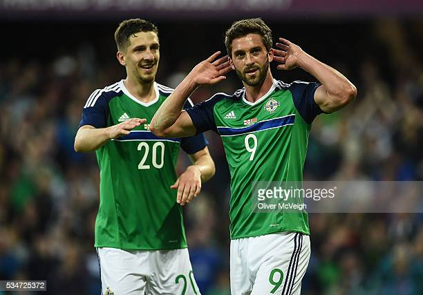 Belfast Ireland 27 May 2016 Will Grigg of Northern Ireland celebrates with Craig Cathcart after scoring his side's third goal during the...
