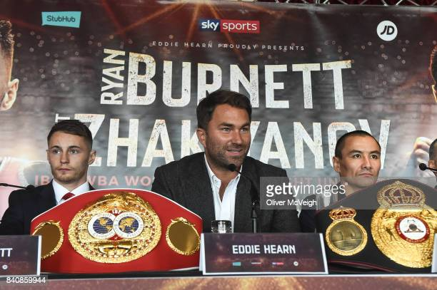 Belfast Ireland 30 August 2017 Promoter Eddie Hearn centre Ryan Burnett left and Zhanat Zhakiyanov during a press conference ahead of the World...