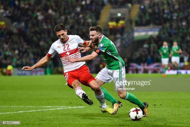 Belfast Ireland 9 November 2017 Fabian Schär of Switzerland in action against Stuart Dallas of Northern Ireland during the FIFA 2018 World Cup...