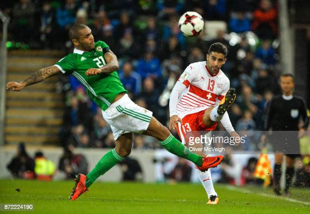 Belfast Ireland 9 November 2017 Ricardo Rodríguez of Switzerland in action against Josh Magennis of Northern Ireland during the FIFA 2018 World Cup...
