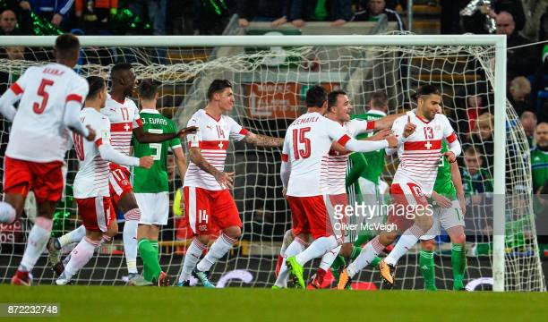 Belfast Ireland 9 November 2017 Ricardo Rodríguez of Switzerland right celebrates with team mates after scoring his sides first goal during the FIFA...