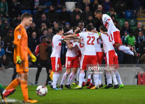 Belfast Ireland 9 November 2017 Ricardo Rodríguez of Switzerland celebrates with team mates after scoring his side's first goal during the FIFA 2018...