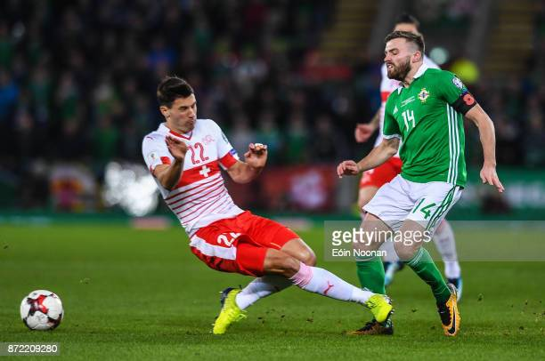 Belfast Ireland 9 November 2017 Stuart Dallas of Northern Ireland is tackled by Fabian Schär of Switzerland for which Schär was shown a yellow card...