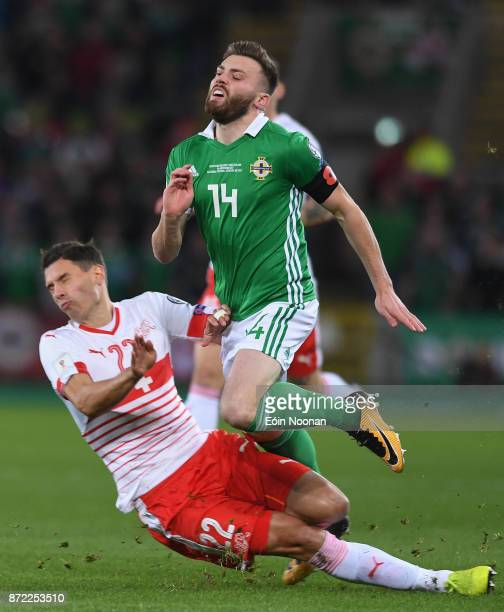 Belfast Ireland 9 November 2017 Stuart Dallas of Northern Ireland is tackled by Fabian Schär of Switzerland during the FIFA 2018 World Cup Qualifier...