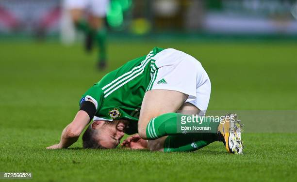 Belfast Ireland 9 November 2017 Stuart Dallas of Northern Ireland reacts after being tackled by Fabian Schär of Switzerland during the FIFA 2018...