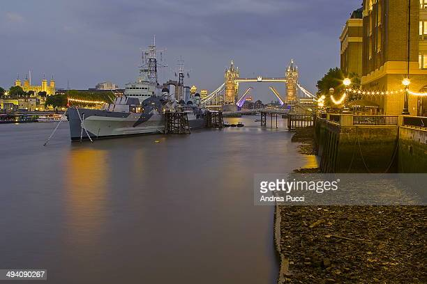 Belfast is a museum ship originally a Royal Navy light cruiser permanently moored in London on the River Thames Near the Tower Bridge Construction of...