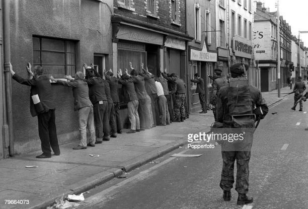 Belfast Northern Ireland 11th August 1971 Civilians lined up against the wall as they are searched by British troops