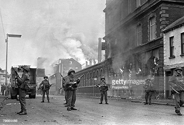 Belfast Northern Ireland 15th August 1969 British soldiers armed with machine guns keeping watch in the Falls Road during rioting