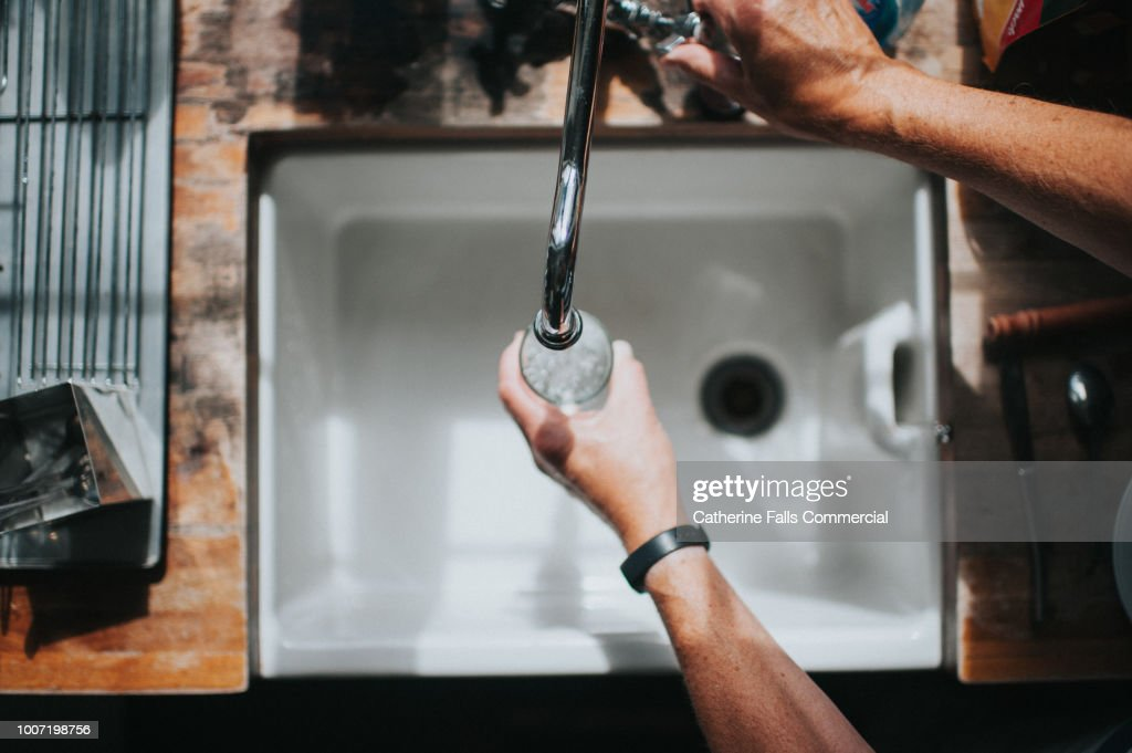 Belfast Sink with Running Water Tap : Stock Photo