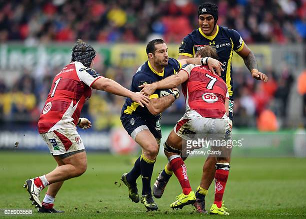 Belfast United Kingdom 10 December 2016 Scott Spedding of ASM Clermont Auvergne is tackled by Kyle McCall left and Chris Henry of Ulster during the...