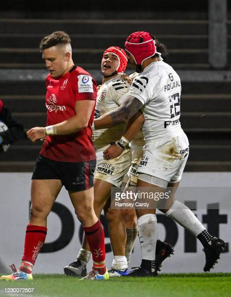 Belfast , United Kingdom - 11 December 2020; Cheslin Kolbe of Toulouse, centre, is congratulated by team-mates after scoring his side's fourth try...