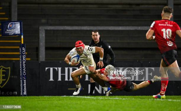 Belfast , United Kingdom - 11 December 2020; Cheslin Kolbe of Toulouse on his way to score his side's fourth try despite the tackle of Michael Lowry...