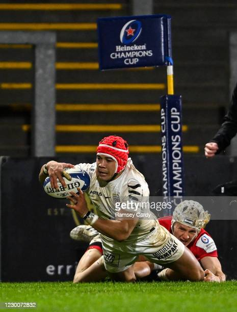Belfast , United Kingdom - 11 December 2020; Cheslin Kolbe of Toulouse goes over to score his side's fourth try despite the tackle of Michael Lowry...