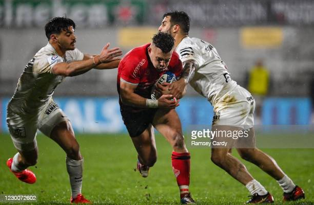 Belfast , United Kingdom - 11 December 2020; Ian Madigan of Ulster is tackled by Romain Ntamack, left, and Sofiane Guitoune of Toulouse during the...
