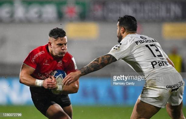 Belfast , United Kingdom - 11 December 2020; Ian Madigan of Ulster is tackled by Sofiane Guitoune of Toulouse during the Heineken Champions Cup Pool...