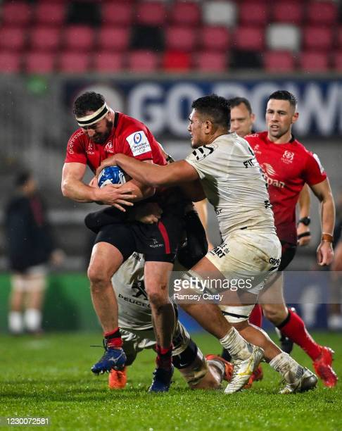 Belfast , United Kingdom - 11 December 2020; Rob Herring of Ulster is tackled by Rynhardt Elstadt, hidden, and Selevasio Tolofua of Toulouse, right,...