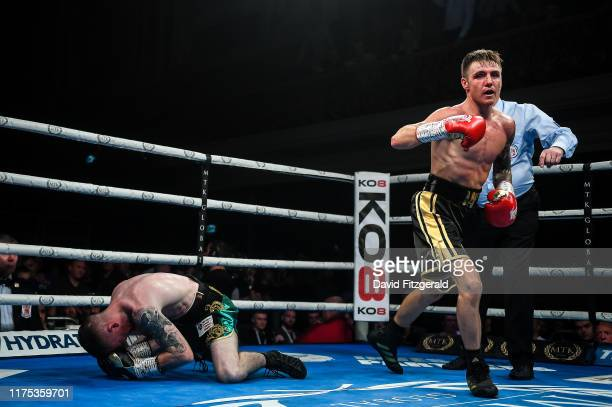 Belfast United Kingdom 11 October 2019 Jay Harris right knocks out Paddy Barnes during their IBF intercontinental flyweight title bout at the MTK...