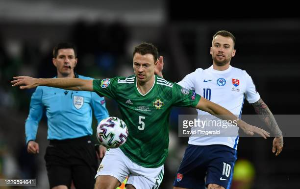 Belfast , United Kingdom - 12 November 2020; Jonny Evans of Northern Ireland in action against Albert Rusnák of Slovakia during the UEFA EURO2020...