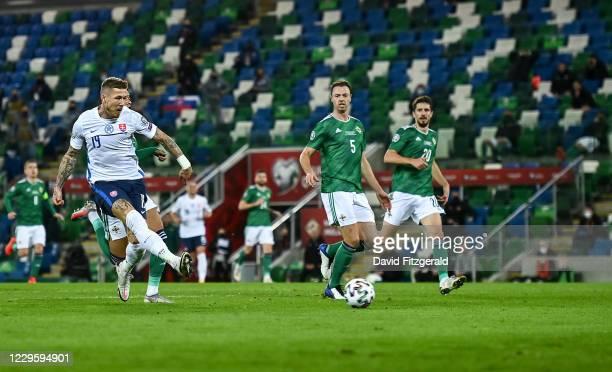 Belfast , United Kingdom - 12 November 2020; Juraj Kucka of Slovakia shoots to score his side's first goal during the UEFA EURO2020 Qualifying...