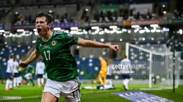 Belfast , United Kingdom - 12 November 2020; Paddy McNair of Northern Ireland celebrates after Milan Škriniar of Slovakia scored an own goal during...