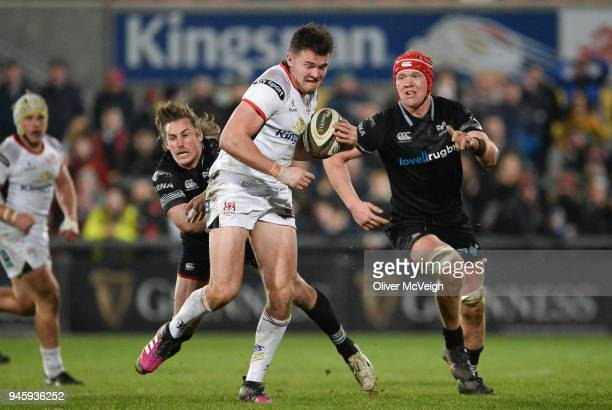 Belfast United Kingdom 13 April 2018 Jacob Stockdale of Ulster on his way to scoring his side's first try in the final minute despite the tackle of...