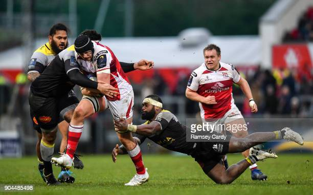 Belfast United Kingdom 13 January 2018 Kieran Treadwell of Ulster is tackled by Mohamed Boughanmi left and Levani Botia of La Rochelle during the...