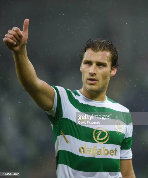 Belfast United Kingdom 14 July 2017 Erik Sviatchenko of Celtic acknowledges the supporters following his side's victory after the UEFA Champions...