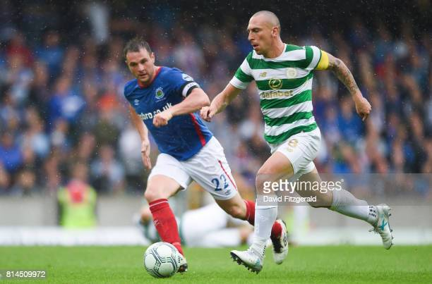 Belfast United Kingdom 14 July 2017 Scott Brown of Celtic in action against Jamie Mulgrew of Linfield during the UEFA Champions League Second...