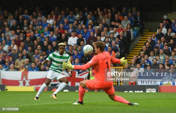 Belfast , United Kingdom - 14 July 2017; Scott Sinclair of Celtic in action against Roy Carroll of Linfield during the UEFA Champions League Second...