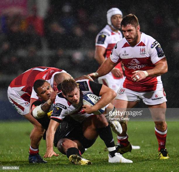 Belfast United Kingdom 15 December 2017 Chris Henry of Ulster is tackled by Kyle Sinckler of Harlequins during the European Rugby Champions Cup Pool...