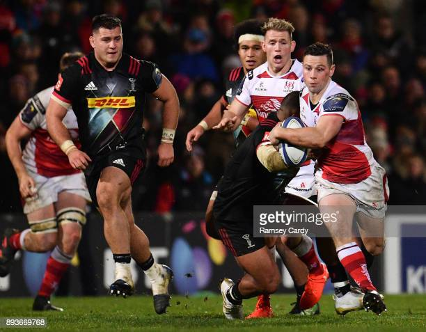 Belfast United Kingdom 15 December 2017 John Cooney of Ulster is tackled by Kyle Sinckler of Harlequins during the European Rugby Champions Cup Pool...