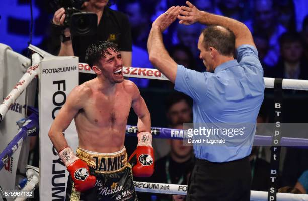Belfast United Kingdom 18 November 2017 Jamie Conlan is stopped by Referee Steve Gray from continuing during his IBF World super flyweight Title bout...