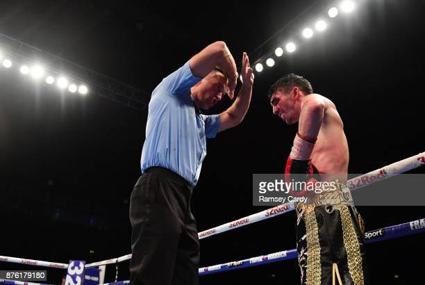 Belfast United Kingdom 18 November 2017 Referee Steve GRay stops the fight between Jamie Conlan and Jerwin Ancajas during their IBF World super...