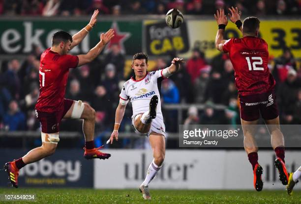 Belfast United Kingdom 21 December 2018 Billy Burns of Ulster in action against Conor Oliver left and Jaco Taute of Munster during the Guinness PRO14...