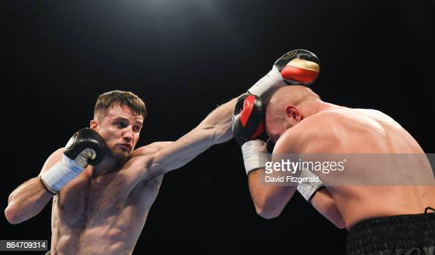 Belfast United Kingdom 21 October 2017 Anthony Fowler left exchanges punches with Laszlo Fazekas during their SuperWelterweight bout at the SSE Arena...
