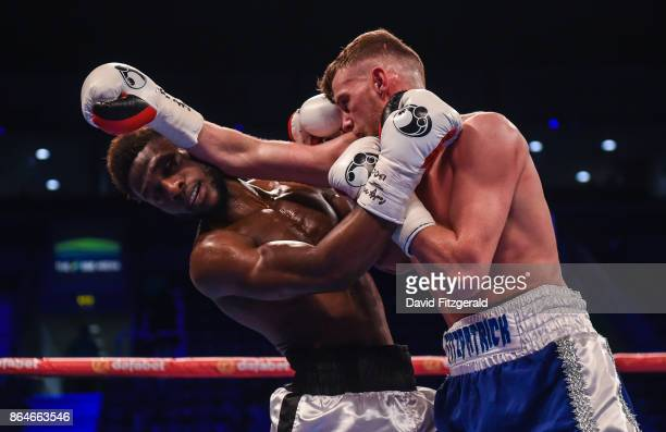 Belfast United Kingdom 21 October 2017 Joe Fitzpatrick right exchanges punches with Mwenya Chisanga during their Lightweight bout at the SSE Arena in...