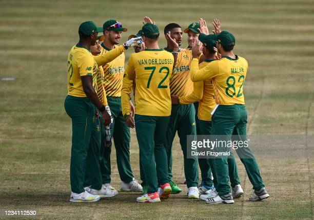 Belfast , United Kingdom - 22 July 2021; Quinton de Kock of South Africa is congratulated by team-mates after catching out Andrew Balbirnie of...