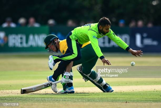 Belfast , United Kingdom - 22 July 2021; Simi Singh of Ireland collides with David Miller of South Africa during the Men's T20 International match...